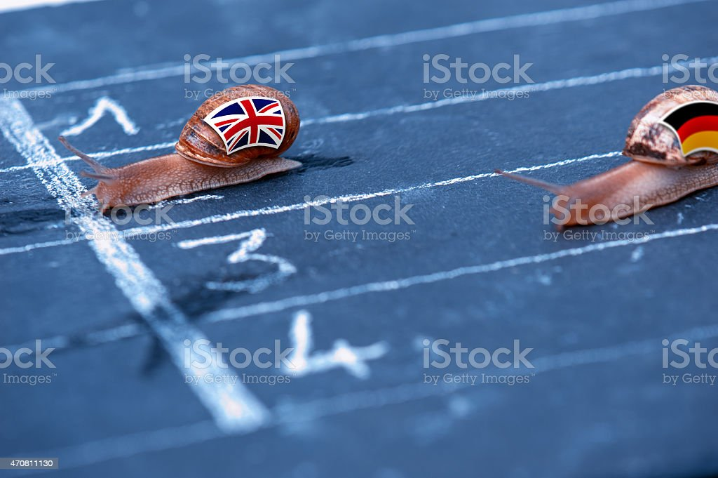 snails race metaphor about England against Germany stock photo