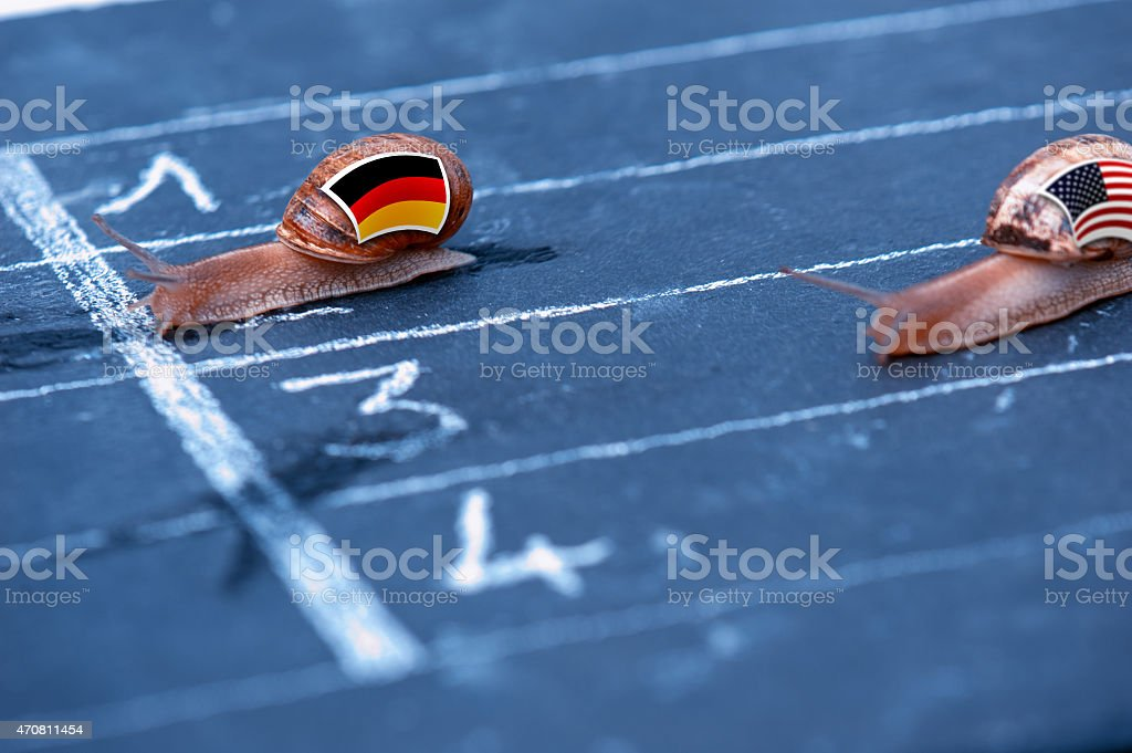 snails race metaphor about Germany against Usa stock photo
