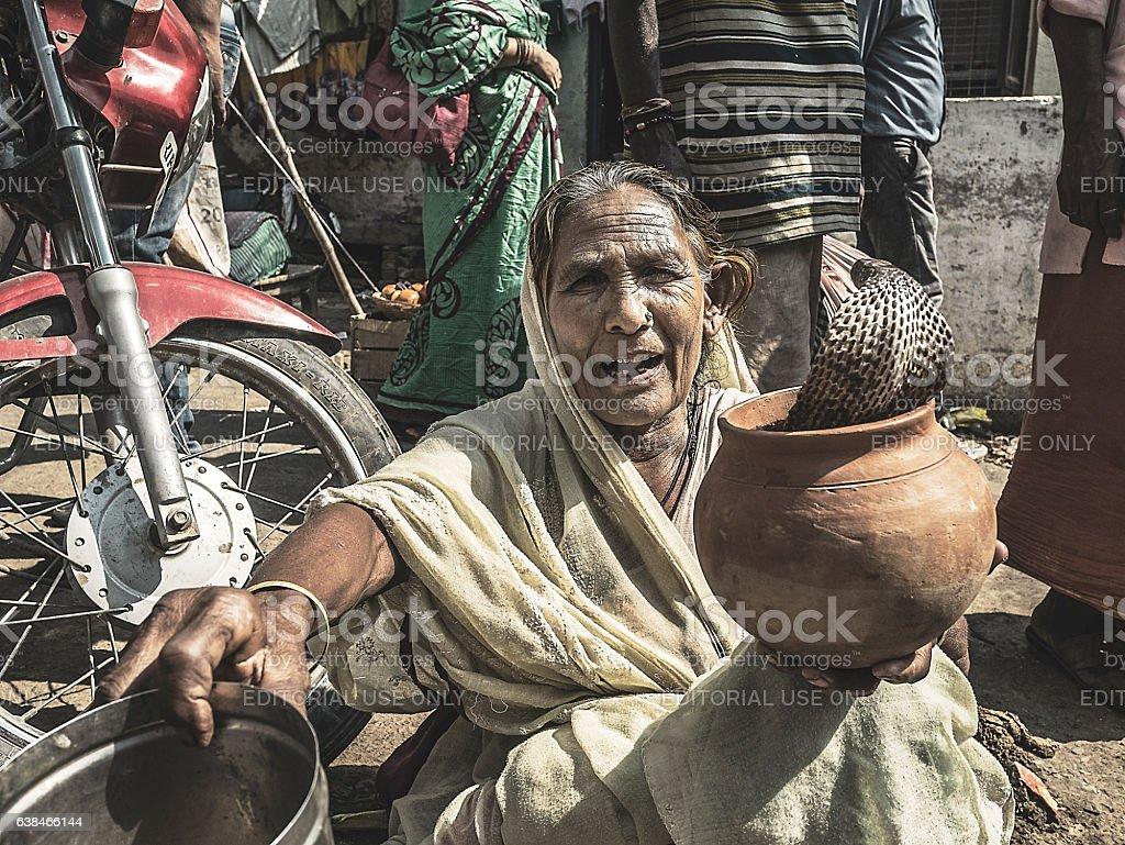 Snake charmer begging in Varanasi India stock photo
