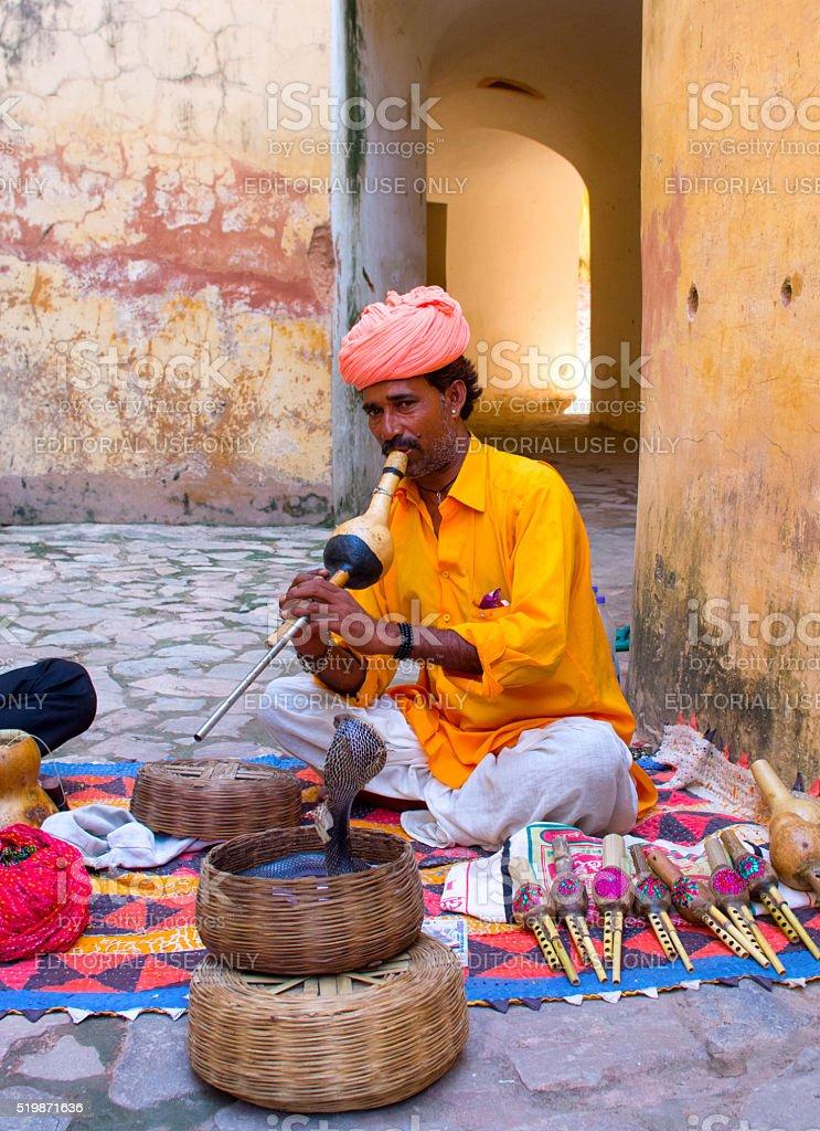Snake charmer in Amber Fort  in Jaipur, India. stock photo