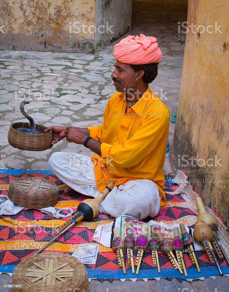 Snake charmer in Amber Fort ,Jaipur, India. stock photo