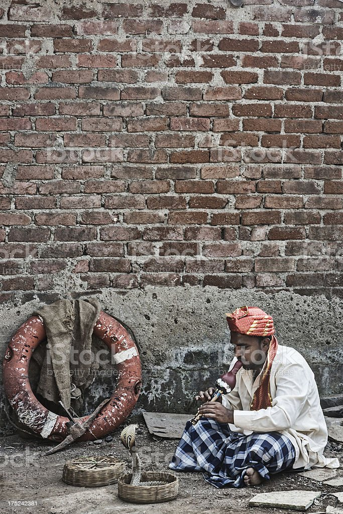 Snake charmer playing royalty-free stock photo