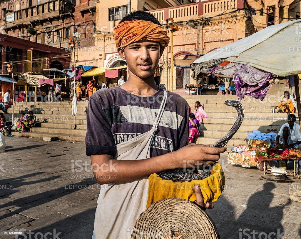 Snake charmer with cobra in Varanasi India stock photo