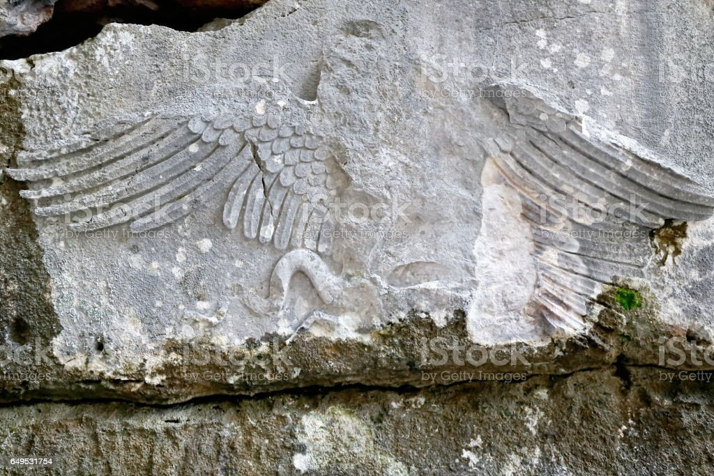 Snake eagle carving on wall of rock-cut tomb. Termessos-Turkey. 1960 stock photo