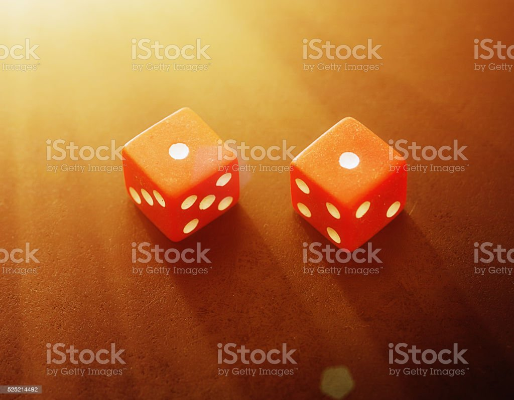 Snake eyes! Red dice show the unlucky score of two. stock photo