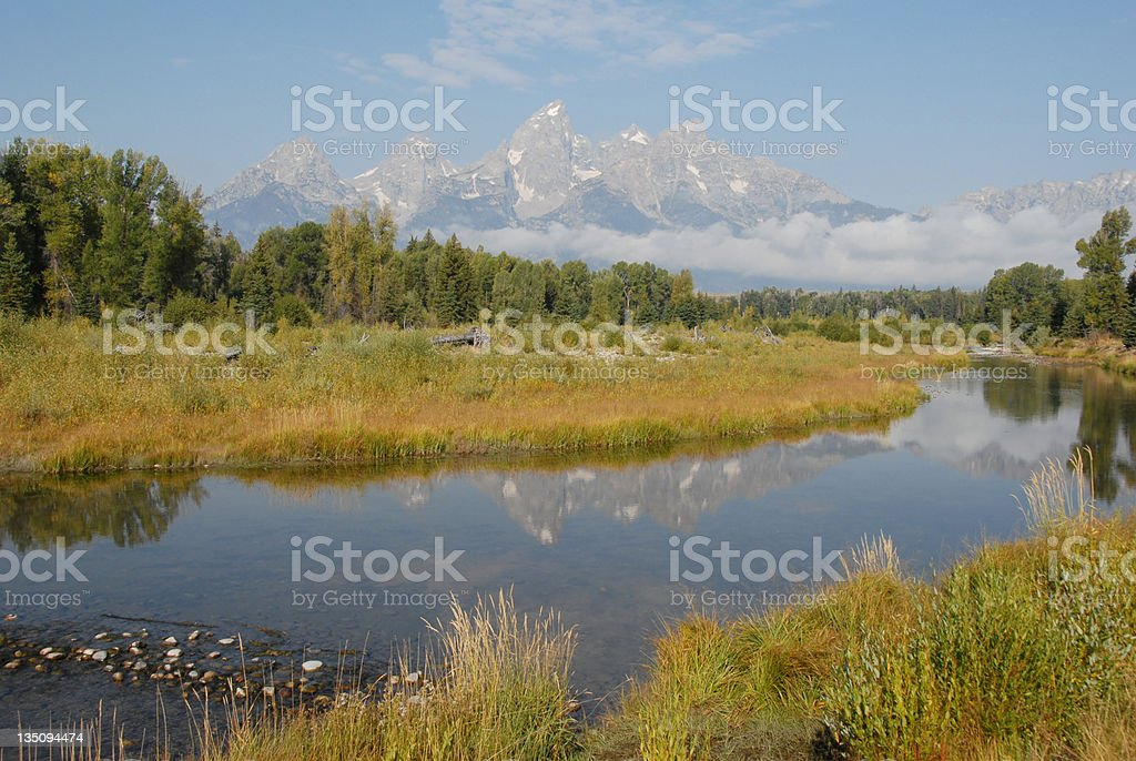 Snake River reflects the Grand Tetons in Wyoming royalty-free stock photo