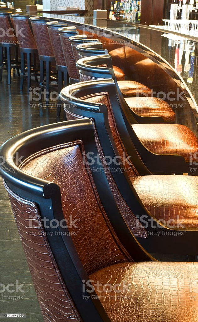 Snakeskin Barstools In High Class Drinking Establishment royalty-free stock photo
