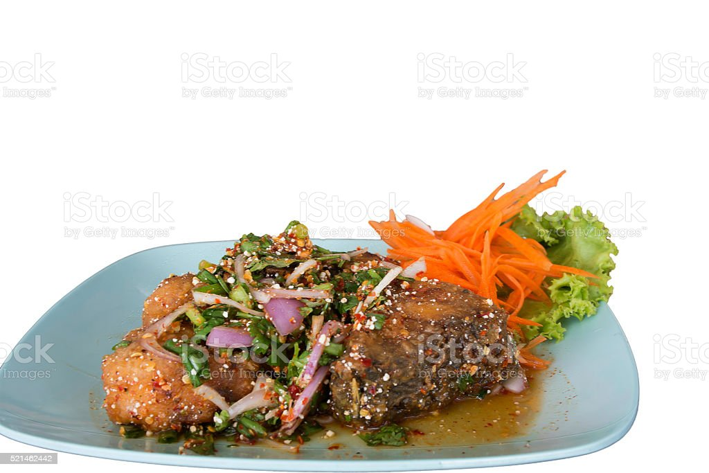 Snapper fish fried served with spicy sauce stock photo