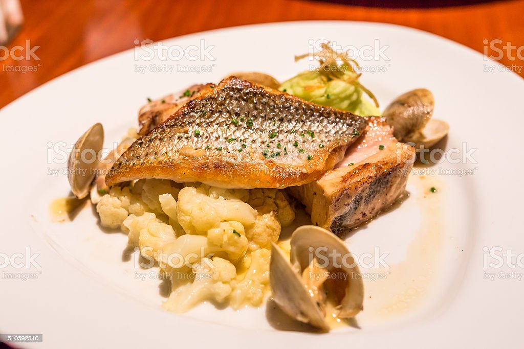 Snapper steak in clam and Cauliflowers sauce stock photo
