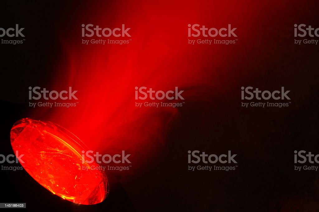 Snapshot of red shiny rugby ball flying with smoky trace stock photo