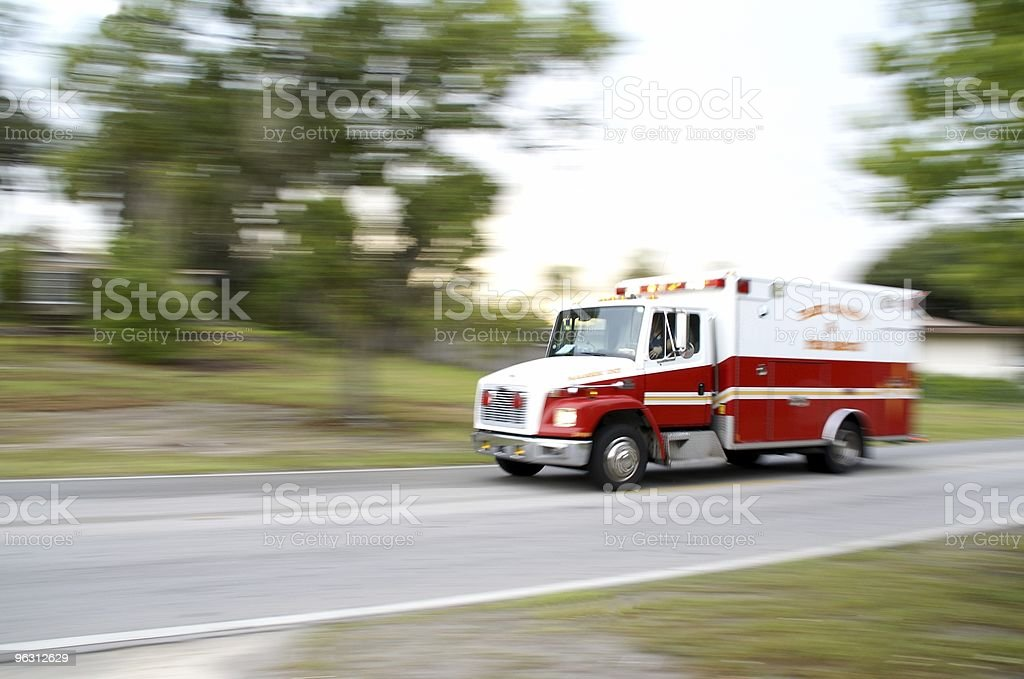 Snapshot of speeding ambulance on job stock photo