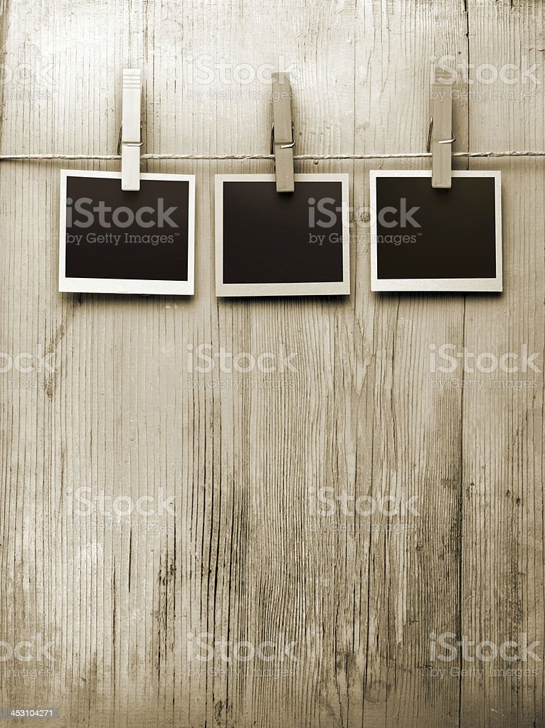 snapshots hanging from a rope stock photo