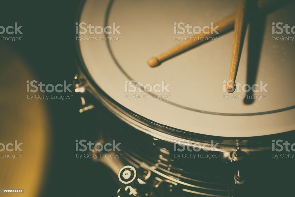 Snare drum and a pair of drum sticks stock photo