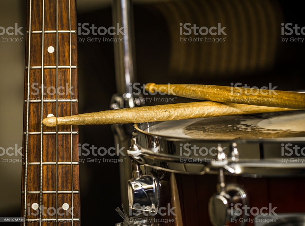snare drum with drumsticks and bass guitar stock photo