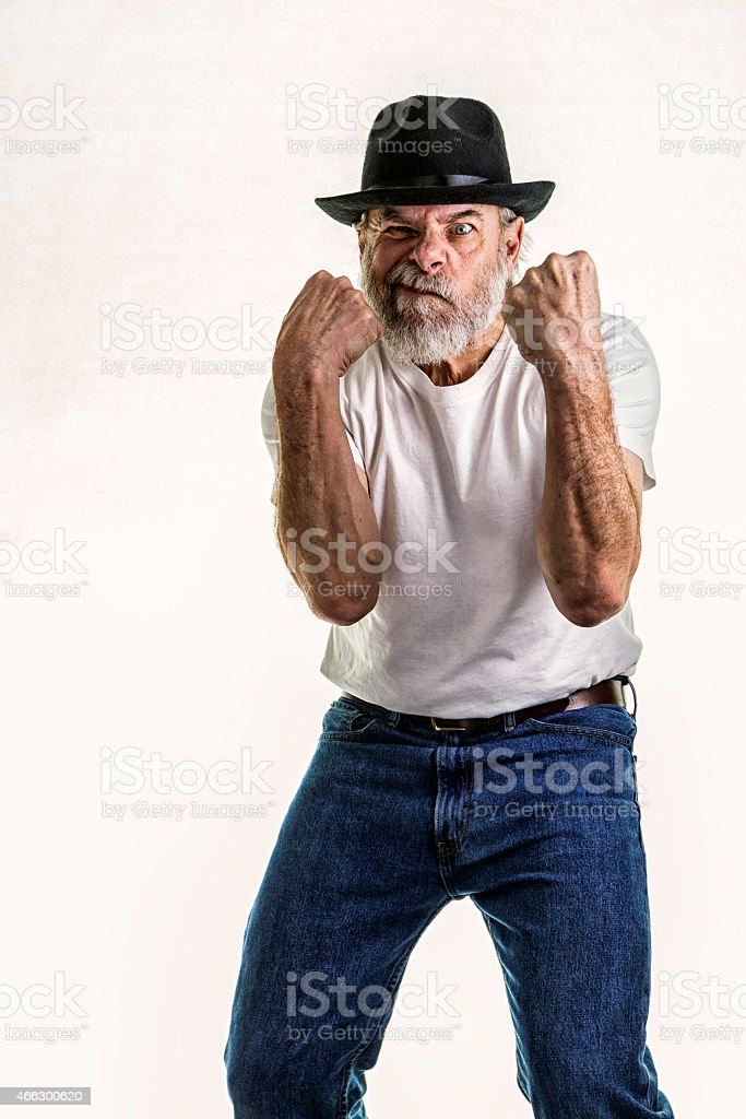 Snarling Senior Man Ready to Fist Fight stock photo