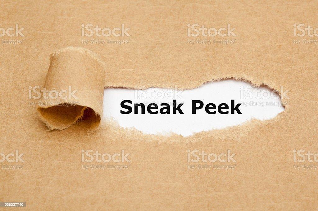 Sneak Peek Torn Paper Concept stock photo