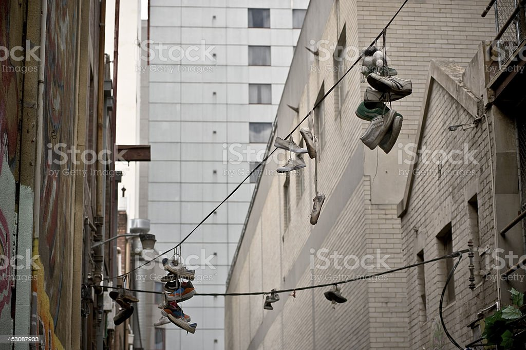 Sneakers hanging from a powerline royalty-free stock photo
