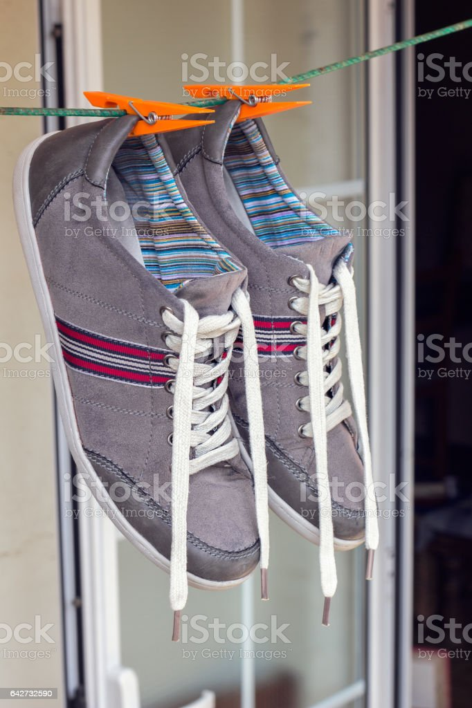 Sneakers hanging on rope stock photo