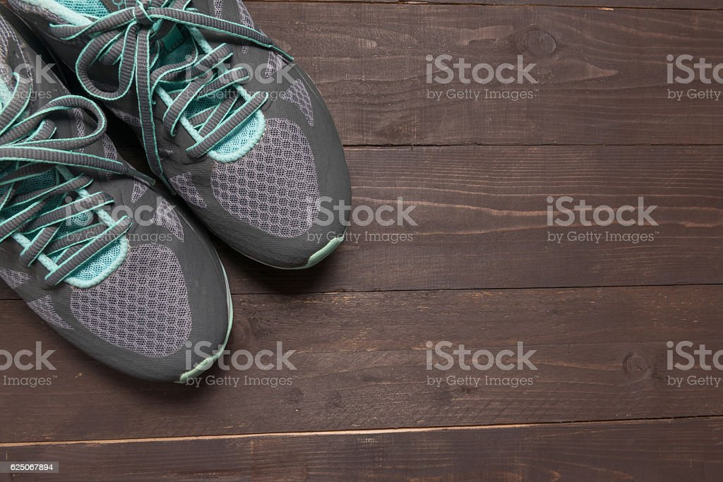 Sneakers is on the wooden background stock photo