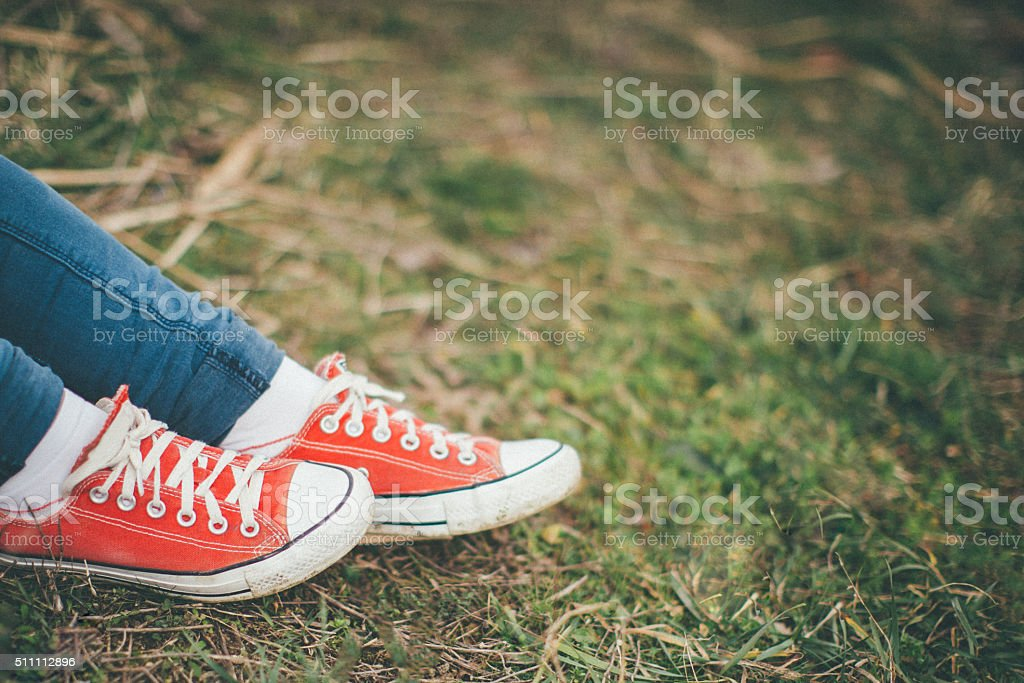 Sneakers on Grass stock photo