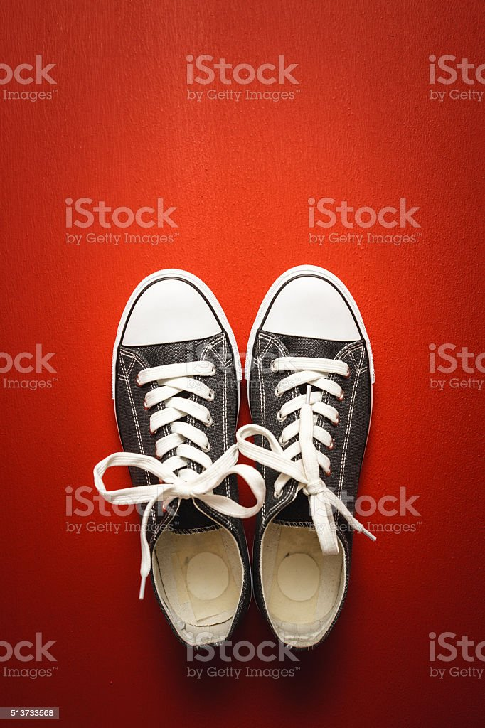 Sneakers on red background stock photo