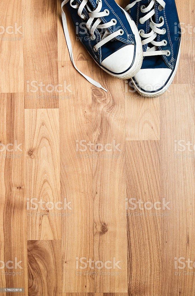 Sneakers On Wood Floor stock photo