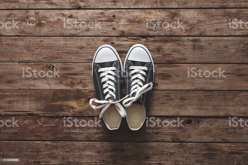 Sneakers on wooden background stock photo