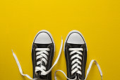Sneakers on yellow background
