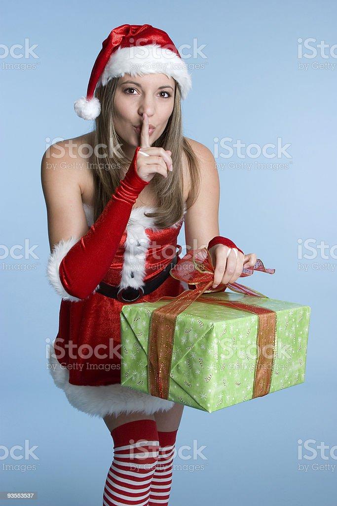 Sneaky Christmas Woman stock photo