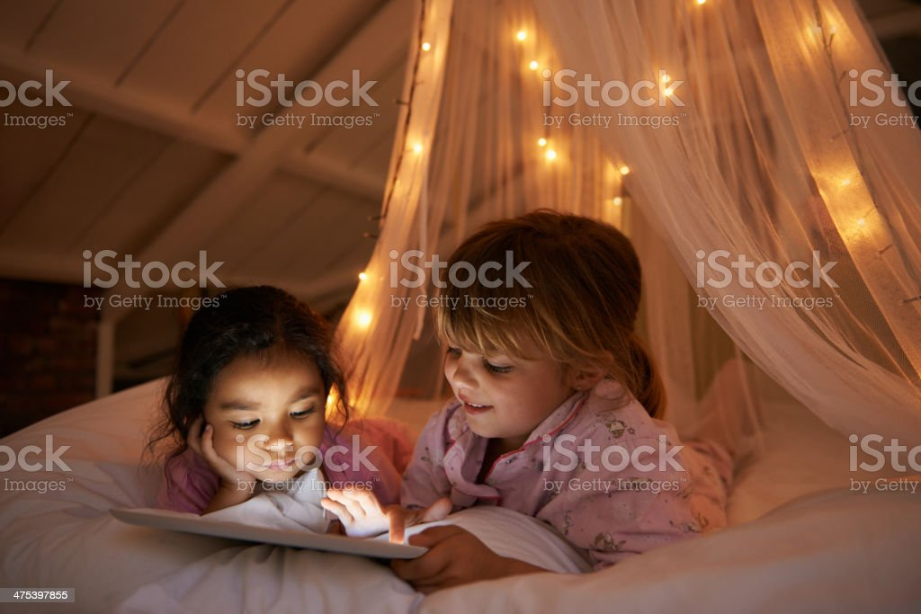 Sneaky night time readers stock photo