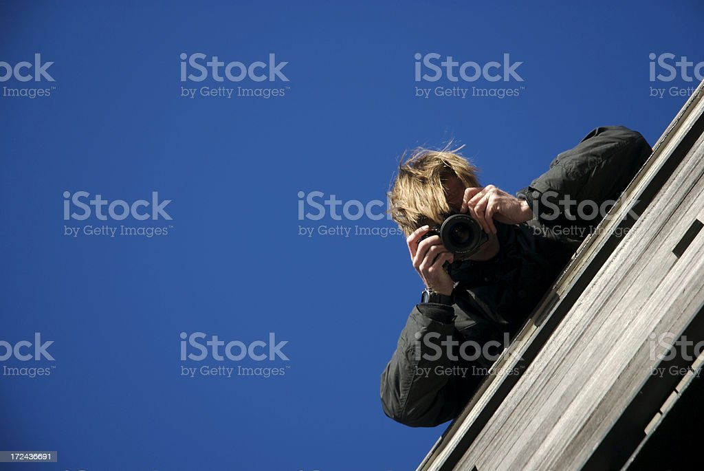Sneaky Photographer Blue Sky royalty-free stock photo
