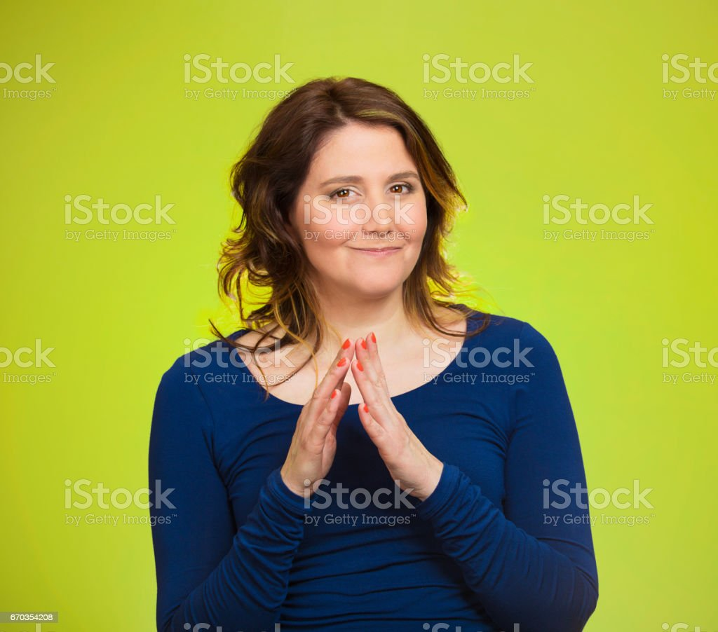 sneaky, sly, scheming middle aged woman trying to plot plan revenge, prankster stock photo