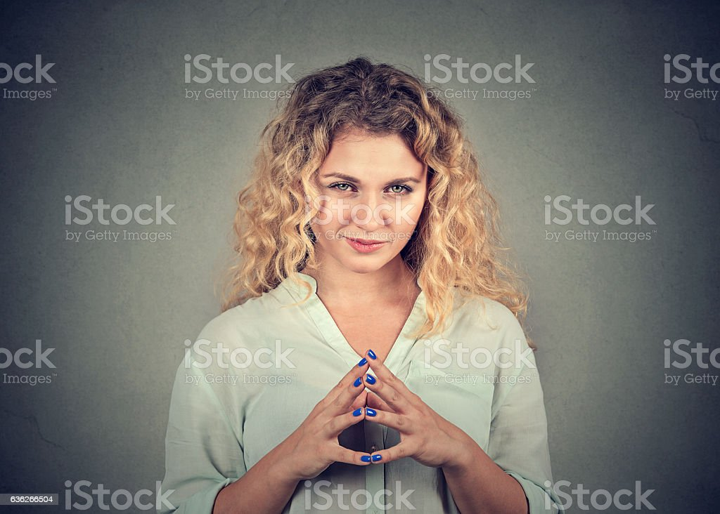 sneaky, sly, scheming woman plotting something stock photo