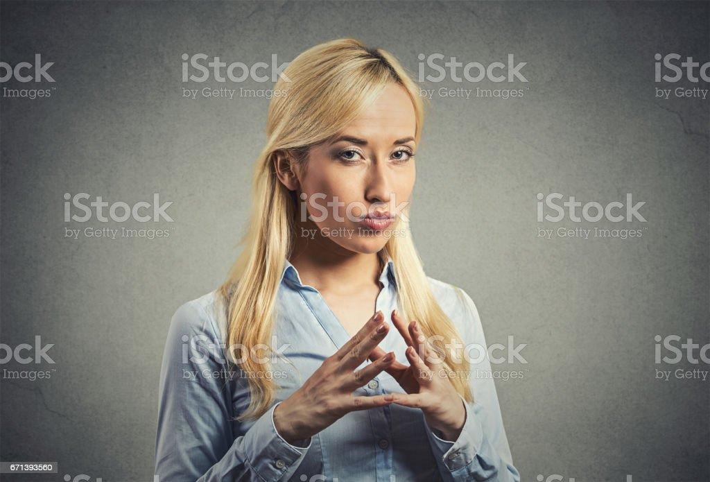 sneaky, sly, scheming young woman plotting revenge plan, prankster stock photo