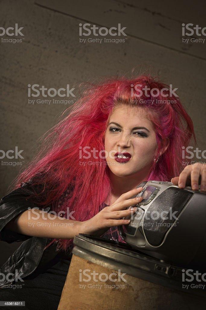 Sneering Girl by Radio royalty-free stock photo