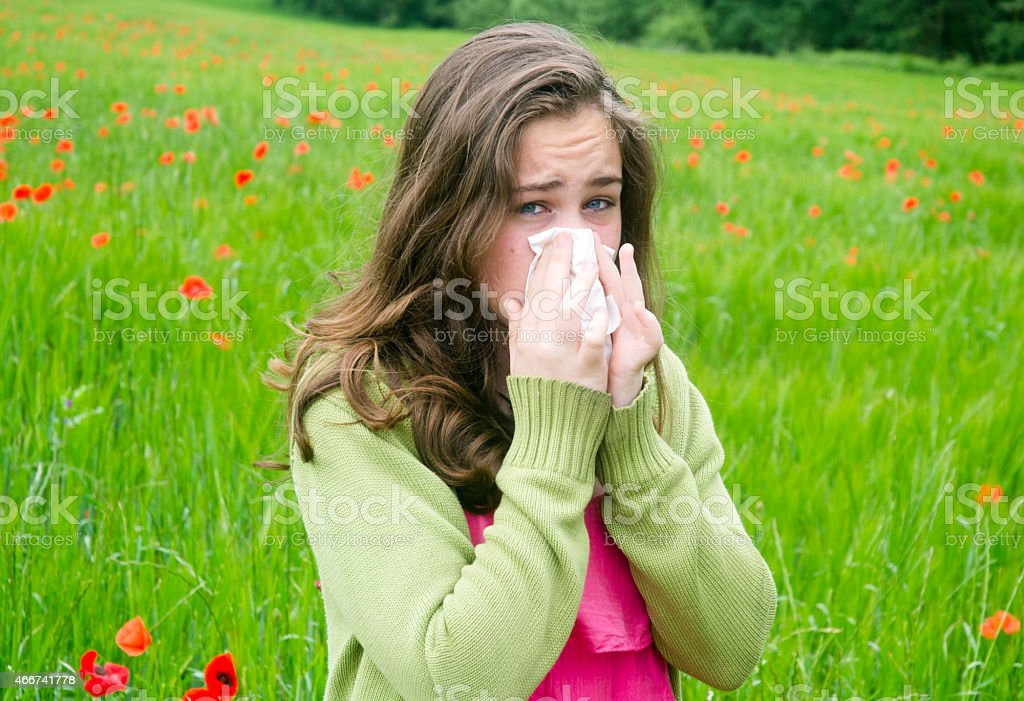 Sneezing, girl with hay fever stock photo