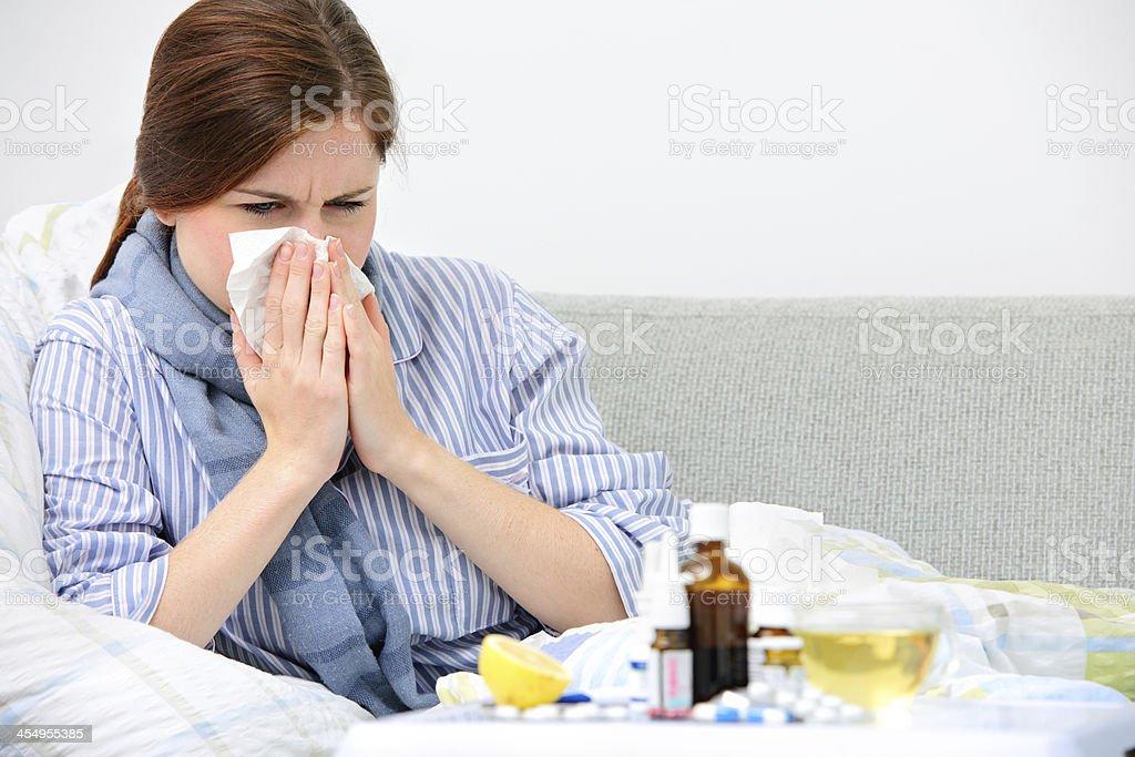 Sneezing woman stock photo