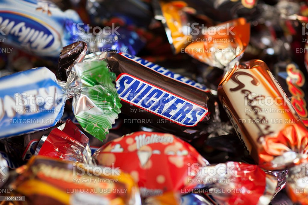 Snickers in candy heap stock photo