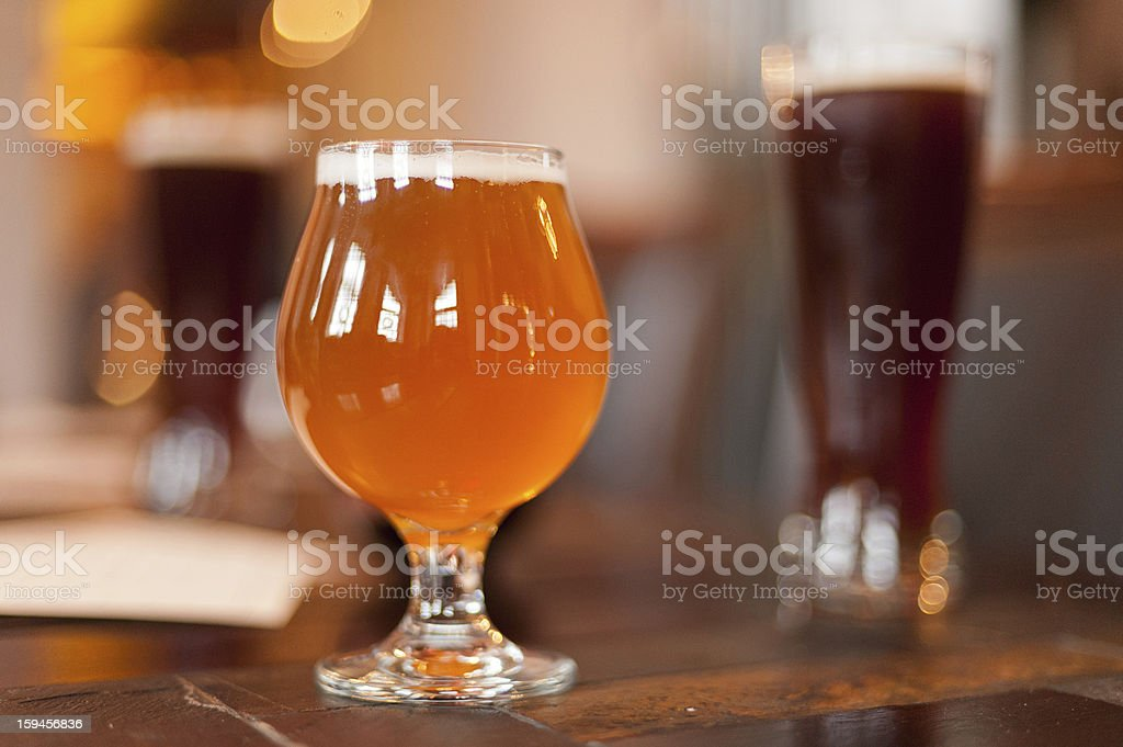 snifter of beer on a table stock photo