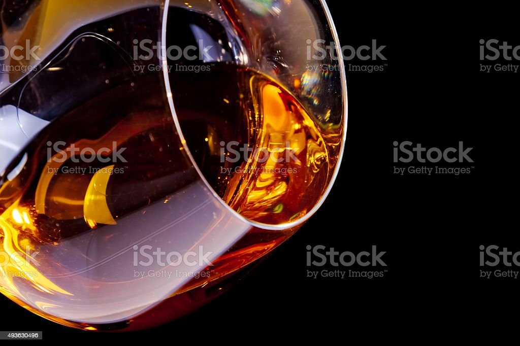 snifter of brandy in elegant glass with space for text stock photo