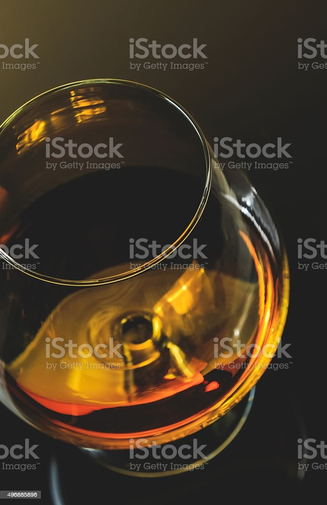 snifter of brandy in elegant typical cognac glass stock photo