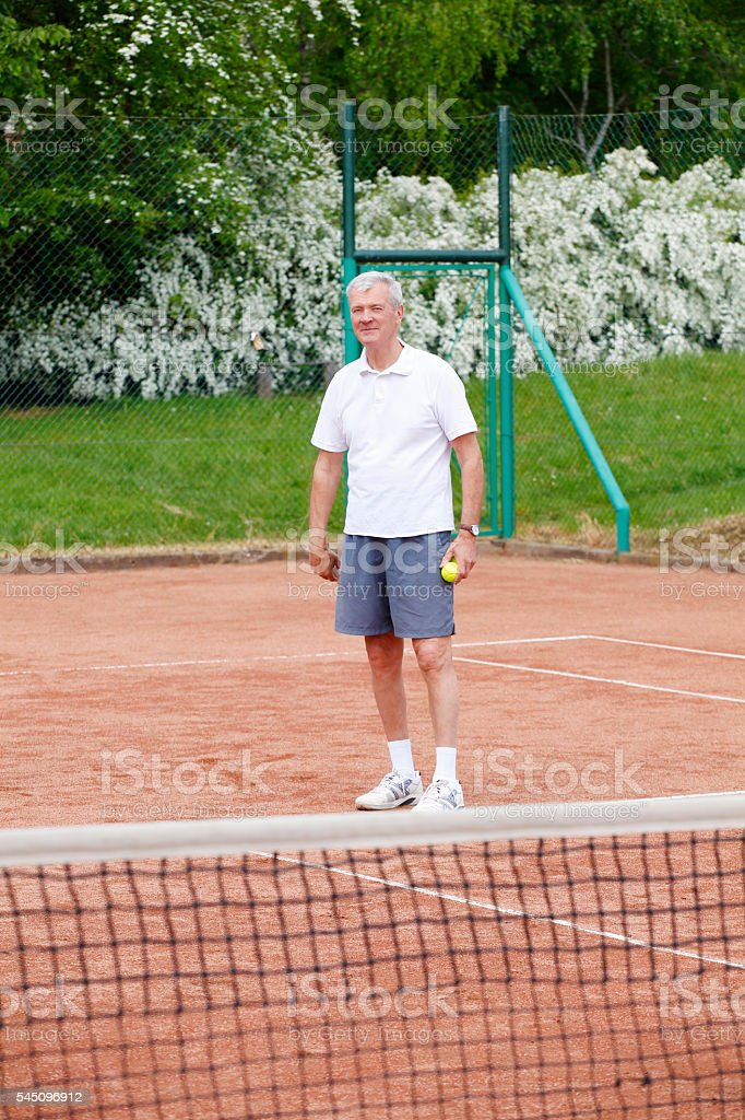 Snior tennis player stock photo