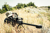 Sniper Aiming with Barrett M82A1 Precision Rifle in Arid Location