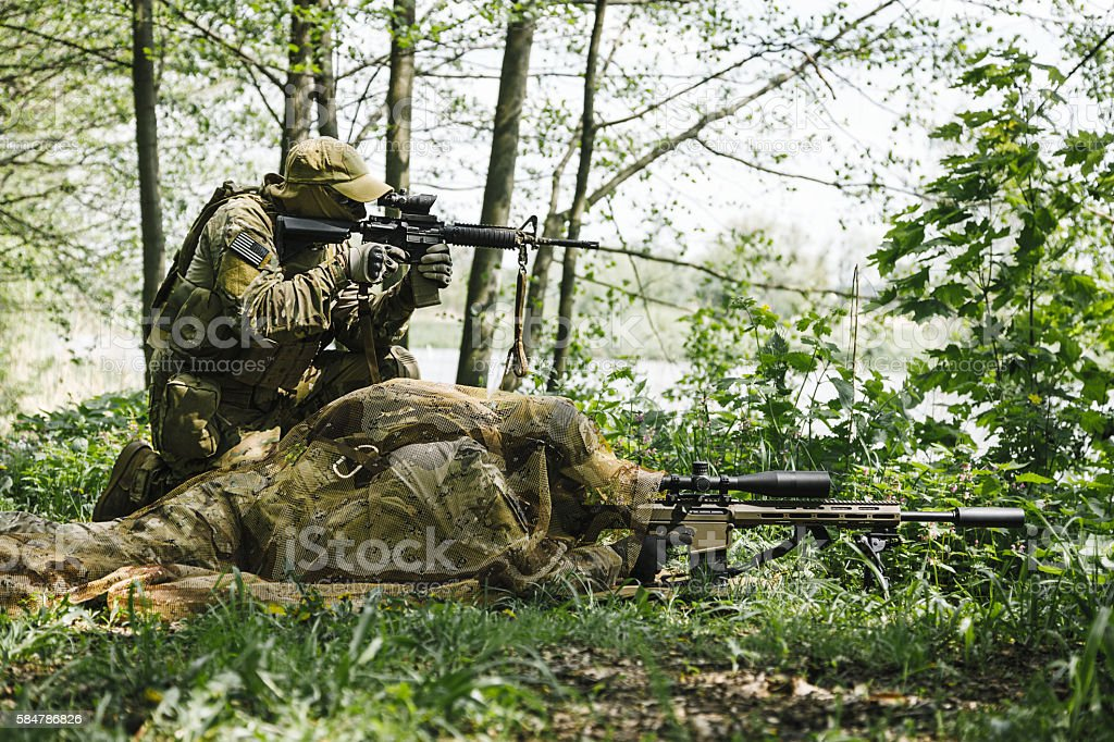 Sniper and spotter of Green Berets stock photo