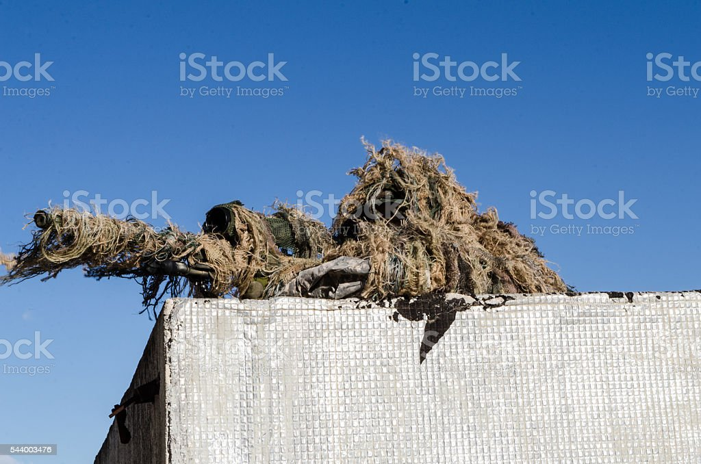 Sniper on roof blue sky stock photo
