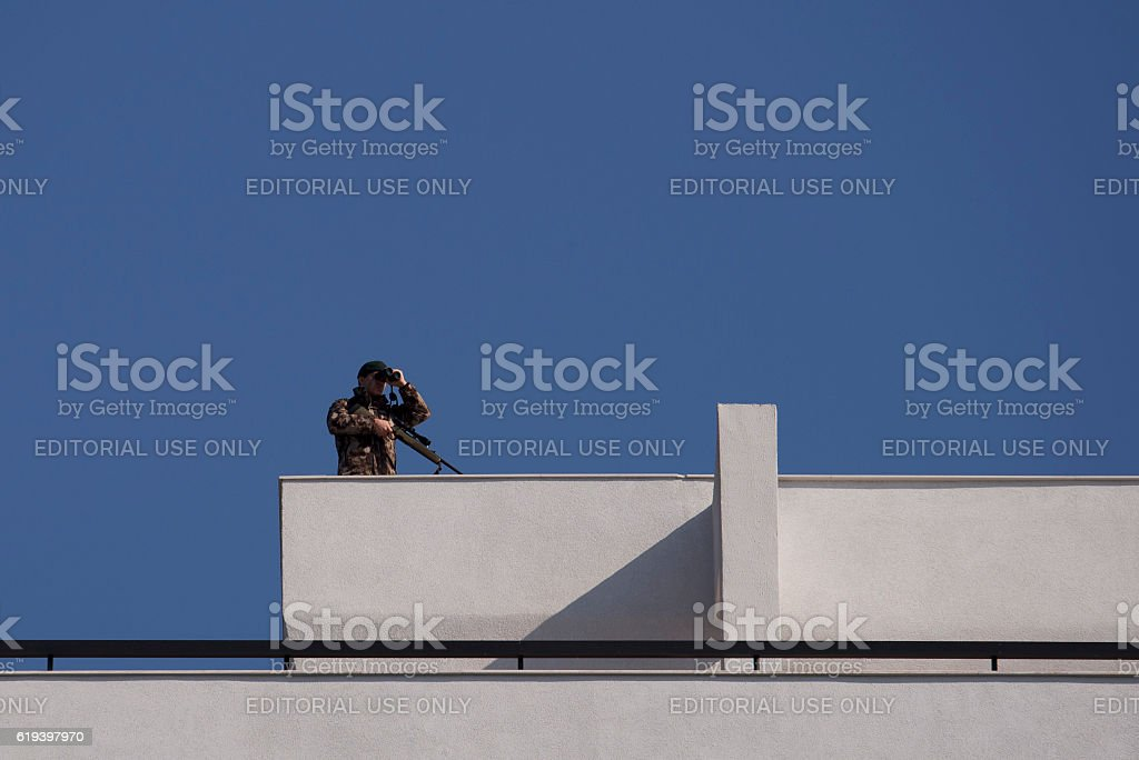 Sniper on the roof. stock photo