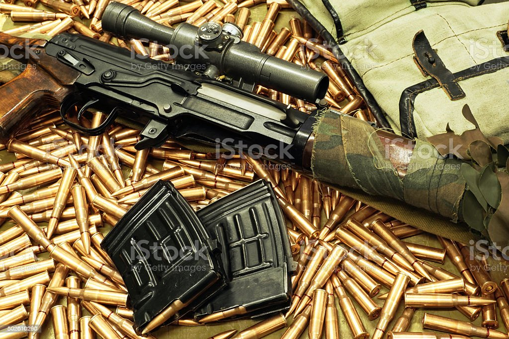 SVD sniper rifle and cartridges stock photo