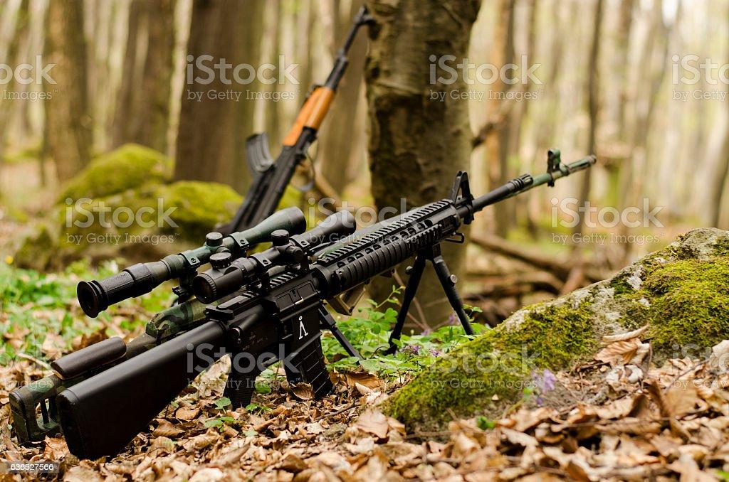 Sniper rifle on bipod on ground background stock photo