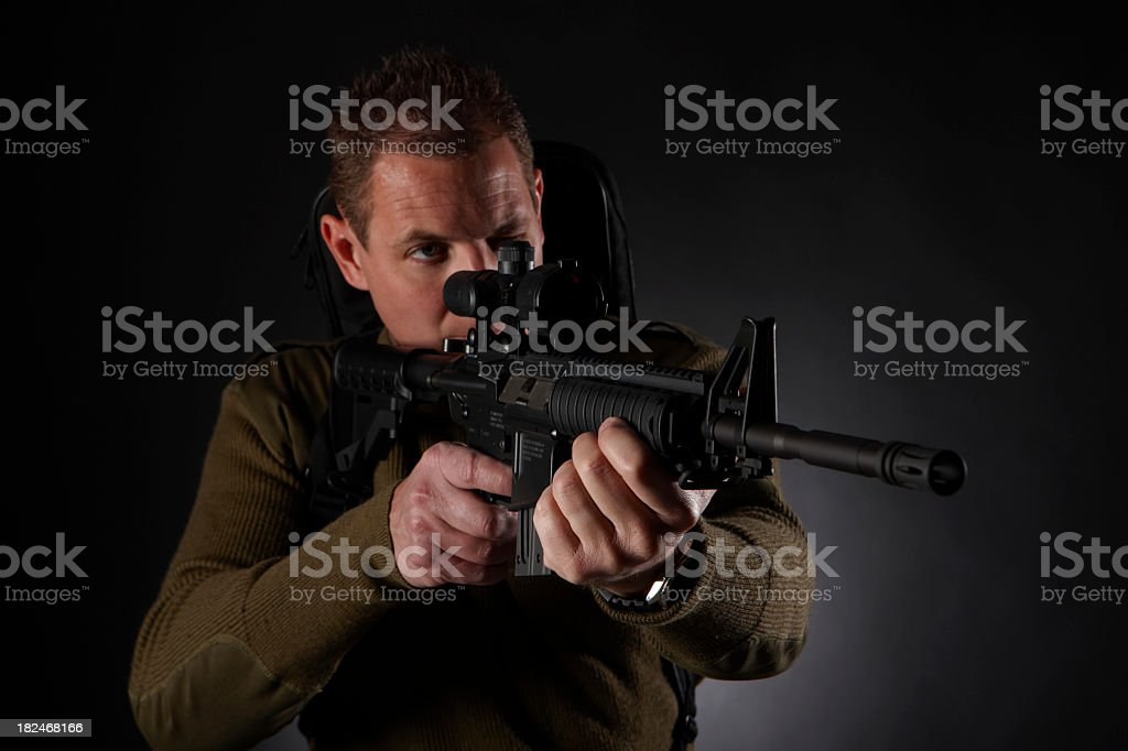 Sniper taking aim royalty-free stock photo