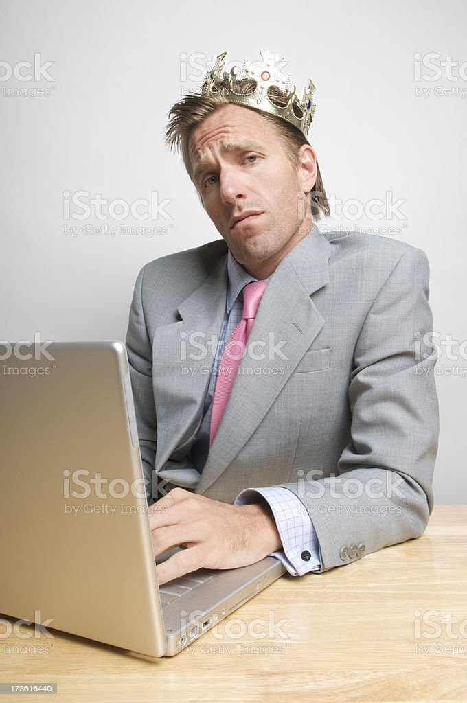 Snob Office Worker Businessman Wearing Crown at Des royalty-free stock photo